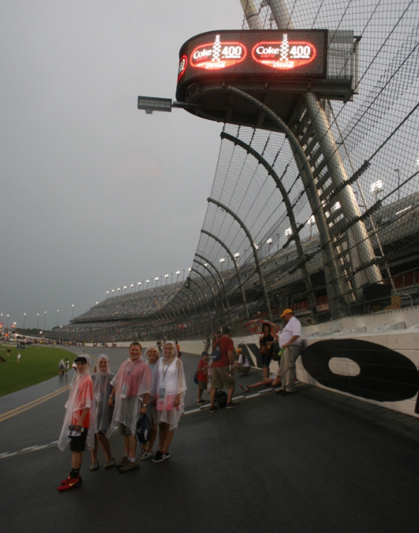 Standing on the track at the Start/Finish Line (notice the angle), looking good in our ponchos.
